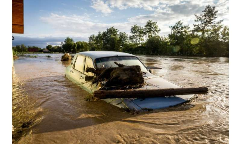Flooding affected around 100 towns across Romania, washing away bridges and destroying dozens of homes