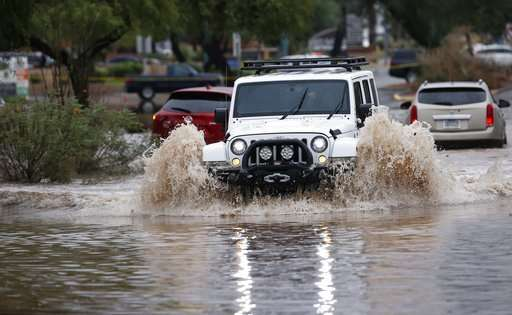 Flooding from remnants of tropical storm traps Phoenix cars