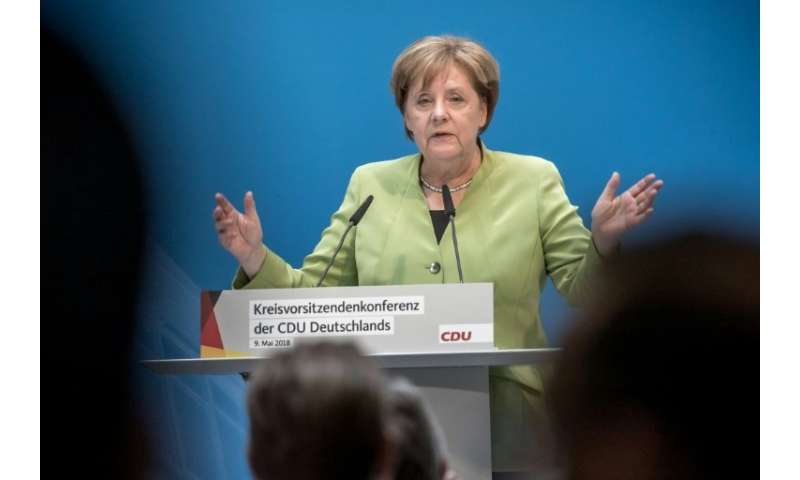 "German Chancellor Angela Merkel has said her country, alongside Britain and France, will ""do everything"" to ensure Ira"