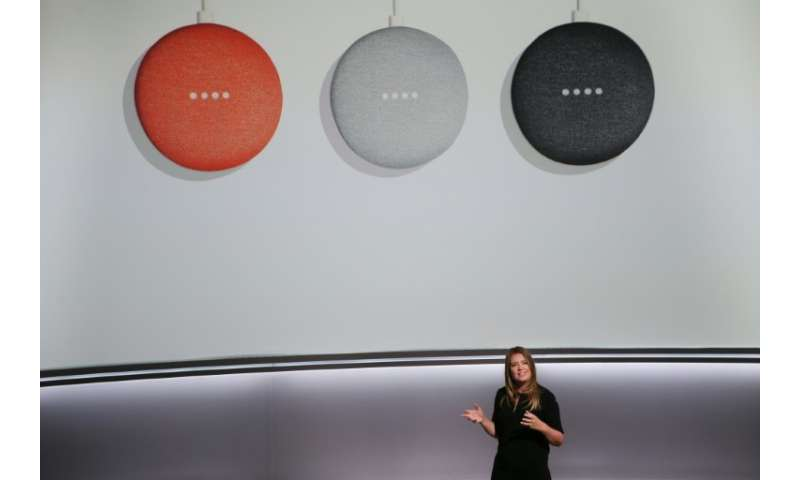 Google Home speakers like these seen at a 2017 presentation have seen sizzling growth over the past year, partly closing the gap