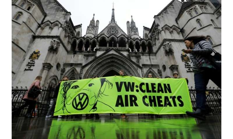 Greenpeace supporters held a protest against Volkswagen over the emissions scandal as a hearing got under way in London