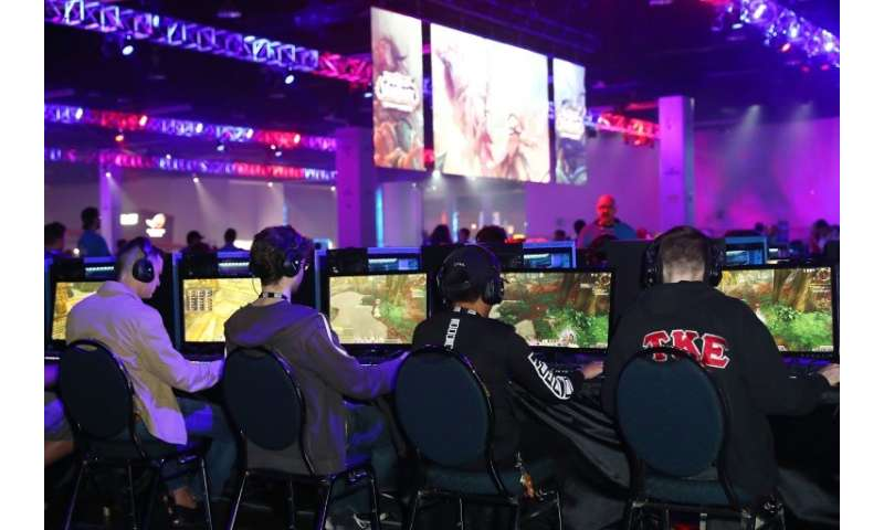 Guests demo the new World of Warcraft game at BlizzCon on November 3, 2017 in Anaheim, California