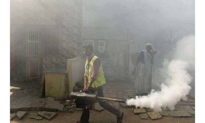 Gujarat has been fumigating public areas in an effort to kill the mosquitos that carry the diseases