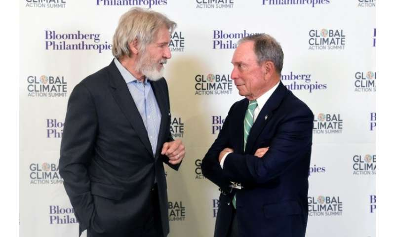 Hollywood star Harrison Ford, pictured with former New York Mayor Michael R. Bloomberg, delivered a rousing address at the Globa