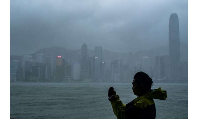 Hong Kong's observatory warned that Mangkhut would pass 100 kilometres south of the city as it raised the storm alert to its hig
