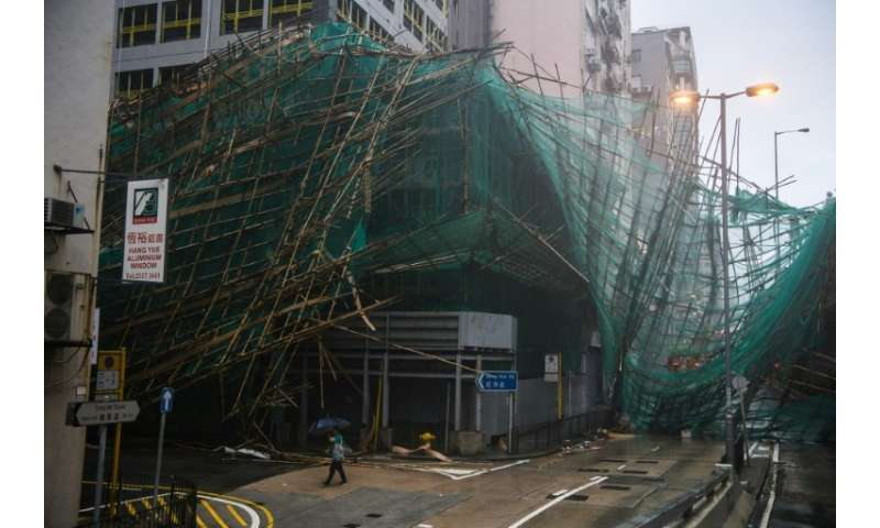 Hong Kong weather authorities issued their maximum alert for the storm, which hit the city with gusts of more than 230 kilometre
