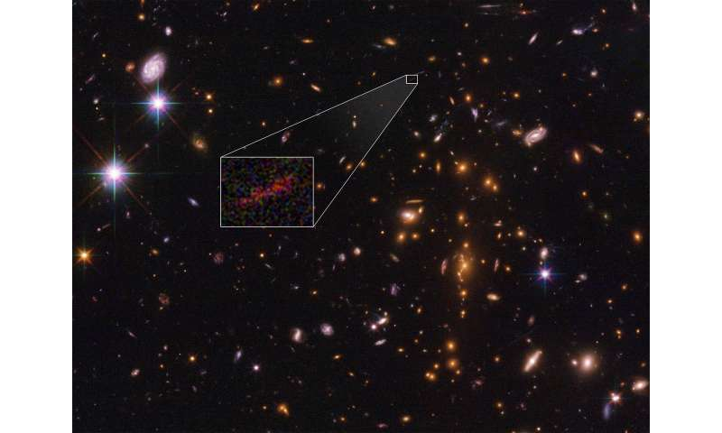 Hubble and Spitzer team up to find magnified and stretched out image of distant galaxy
