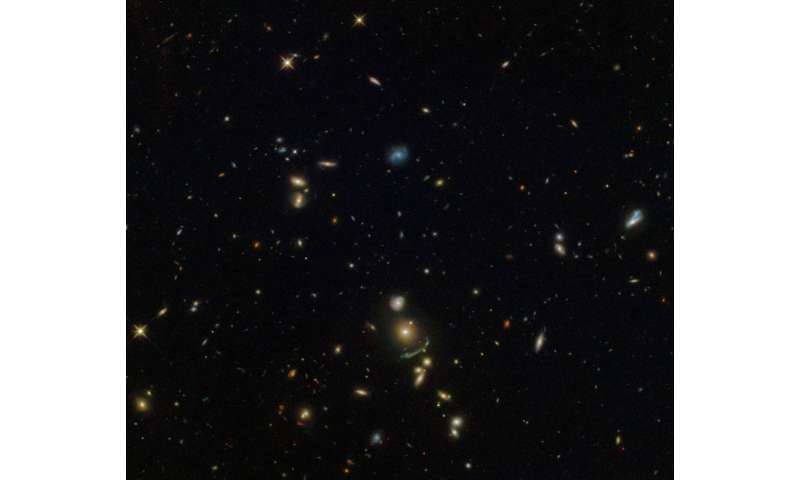 Hubble spots a green cosmic arc