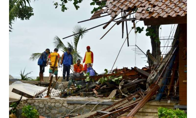 Hundreds of buildings were destroyed by the wave, which hit the coast of southern Sumatra and the western tip of Java Saturday n