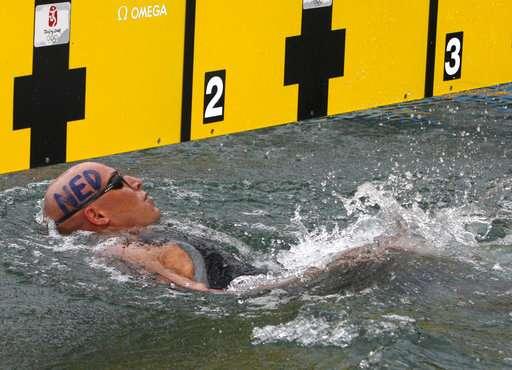 Ill health forces Dutch Olympian to halt long-distance swim