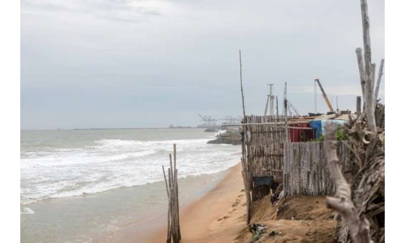 In the beachfront village of Agebkope on Togo's shore, houses have been swept into the sea and others teeter on the brink as coa