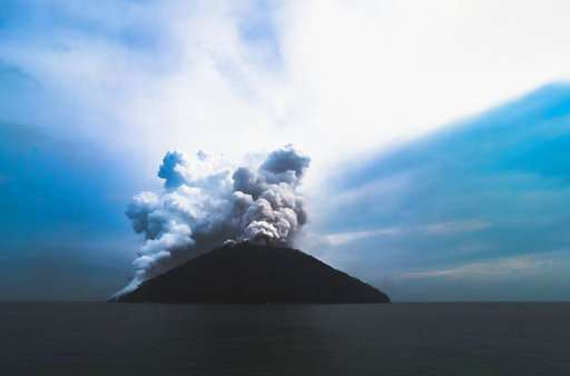 Island volcano in Papua New Guinea erupts with ash, steam