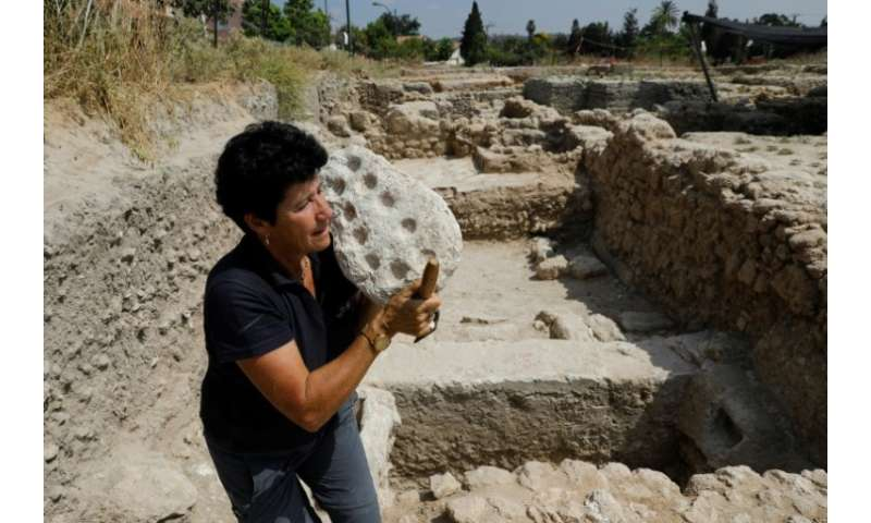 Israel Antiquities Authority archaeologist Alla Nagorsky carries a 1,600-year-old Mancala game from the Byzantine time found dur