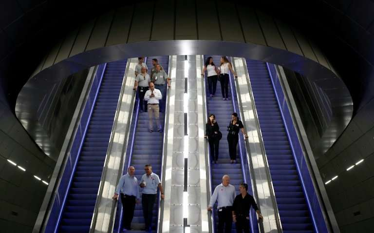Israelis descend to the platforms of Yitzhak Navon station 80 metres (260 feet) below the streets of Jerusalem to test the new h