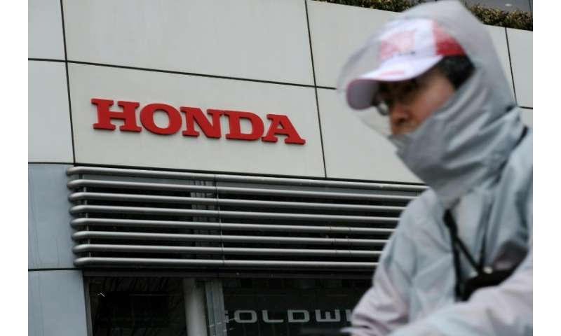Japan's Honda Motor has revised up net profit and sales forecasts