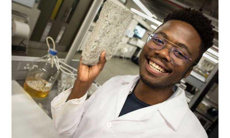 Mind over bladder: Vukheta Mukhari, one of the developers of the world's first bio-brick based on human urine, shows off a proto