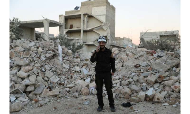 "Mohammed Hamroush, a member of the ""White Helmets"" in Syria uses an app on his smartphone to track bombardments"