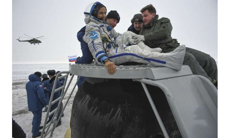 NASA astronaut Joe Acaba is helped out of the Soyuz MS-06 space capsule
