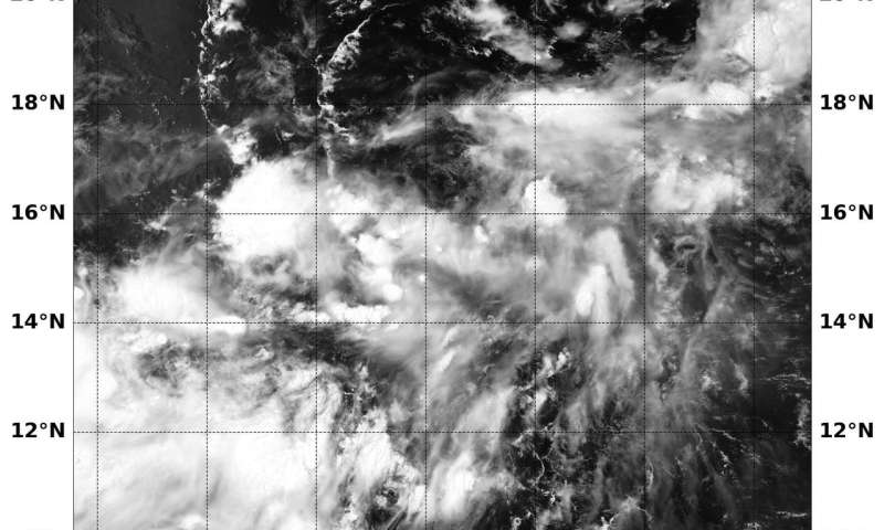 NASA finds an ill-defined Tropical Depression 15W getting organized