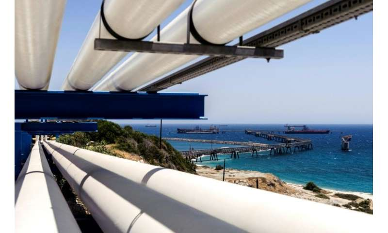 Oil pipes extend from the southern Cypriot village of Zygi towards the oil storage terminal at the port of Vasilikos in the coas