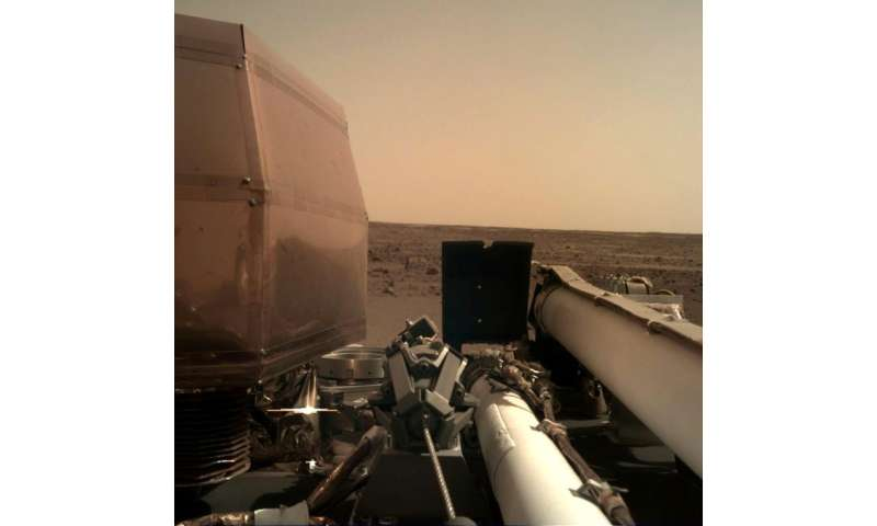 One of the first images taken by the Mars InSight lander and published by NASA after the landing of the probe on the surface of the Red P