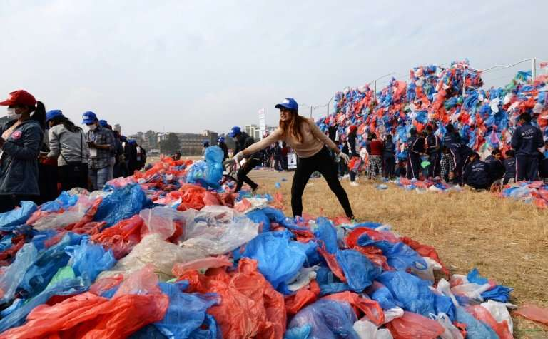 Over 150 volunteers worked for months to collect and sort used plastic bags from schools and public areas in Nepal