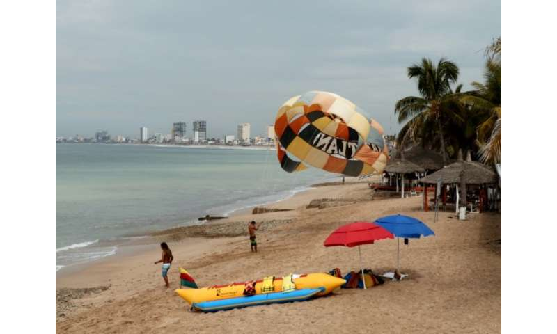 People enjoy the beach in Mazatlan, Mexico on October 21, 2018, ahead of an expected hit from Hurricane Willa