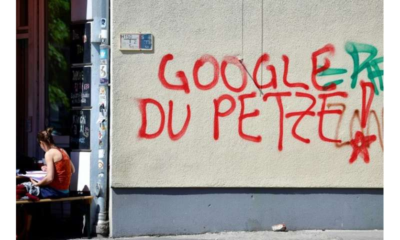 Reads This Graffiti Which Appears To Accuse The Tech Giant Of Passing On Information To Security Services
