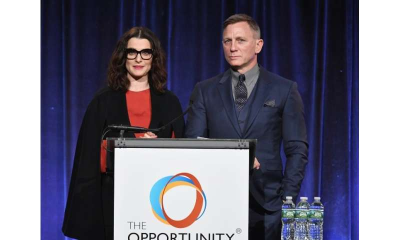 Rachel Weisz and Daniel Craig attend a fundraiser for The Opportunity Network, to which Craig is donating proceeds from the sale