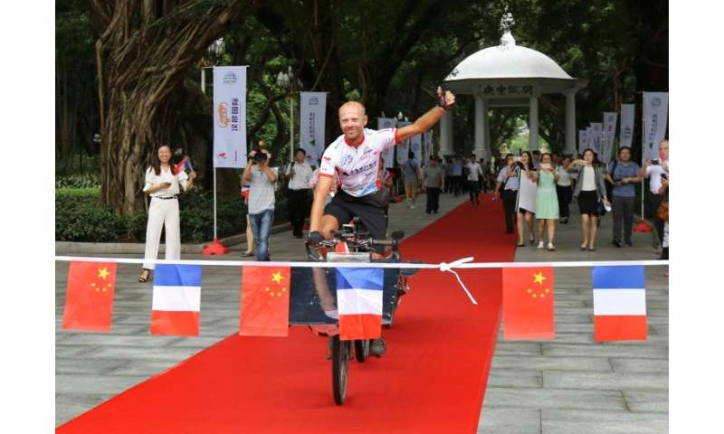 Raf van Hulle took just 49 days to complete the 12,000 kilometre journey from the French city of Lyon to Guangzhou in southern C