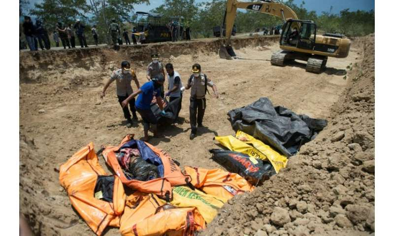 Rescue officials have been keen to bury victims in mass graves to stop the spread of disease
