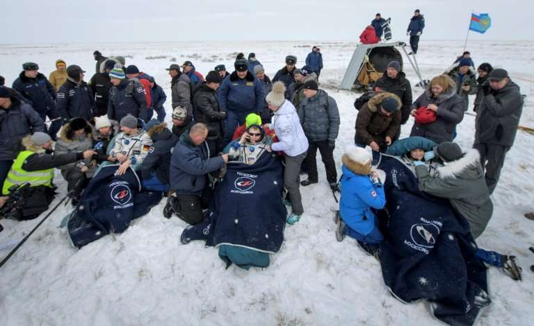 Rescuers pulled the crew members out of the capsule
