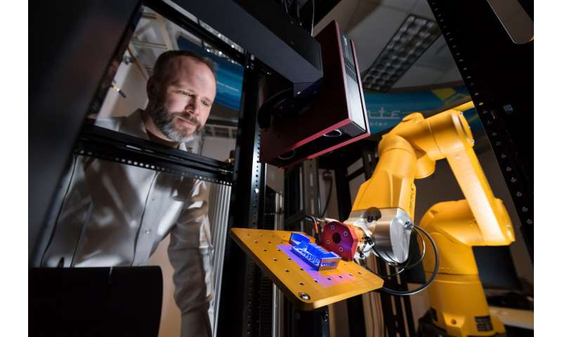Robotic work cell conducts high-throughput testing instantly
