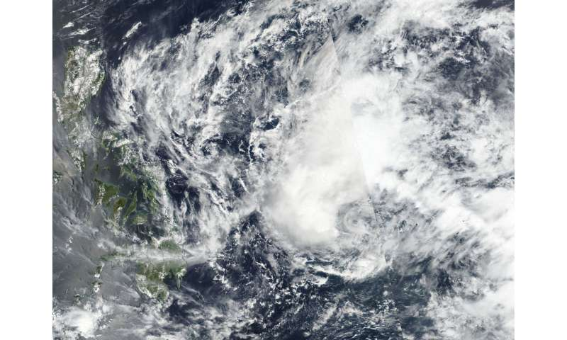 Satellite finds southerly wind shear affecting Tropical Depression Jelawat