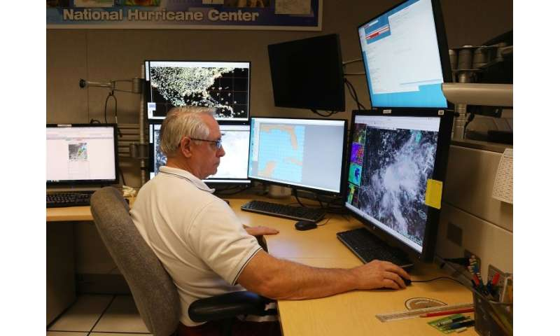 Senior Hurricane specialist Stacy Stewart works at the National Hurricane Center to track the first tropical or subtropical depr