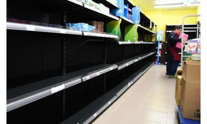Shelves usually stacked with toilet paper, kitchen paper and boxed tissues stood empty in many supermarkets