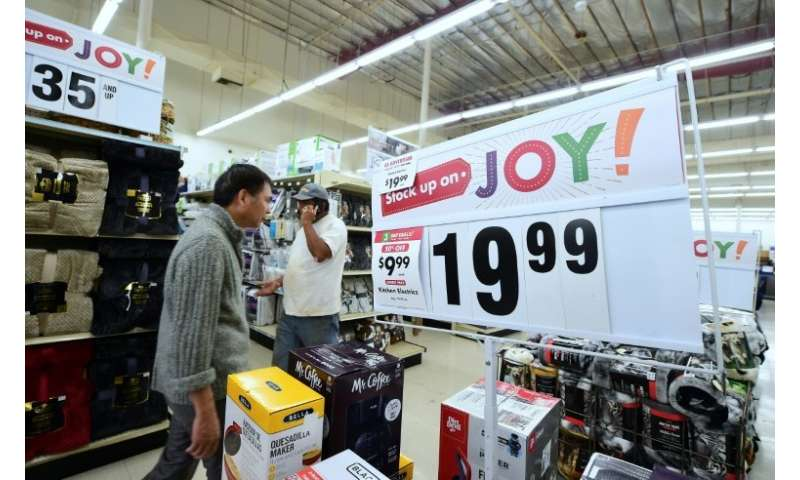 Shoppers walk the aisles at a Big Lots store open early with Black Friday sales on Thanksgiving Day in Alhambra, California on N
