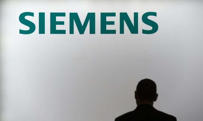 Siemens, which runs its business year from October to September, said net profit jumped by 12 percent to 2.2 billion euros ($2.7