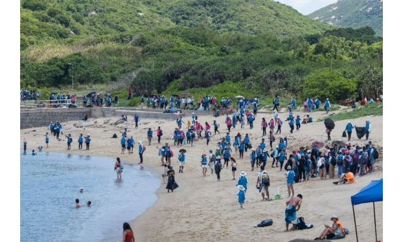 "Sunday's clean-up took place on Shek Pai Wan, near Sham Wan—known as ""Turtle Cove""  — on Hong Kong's Lamma Island"