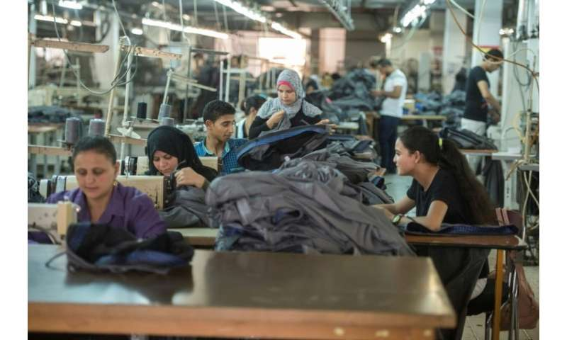 Tailors work at the Marie Louis factory, where long-fibre Egyptian cotton is used to produce high quality clothing for sale in F