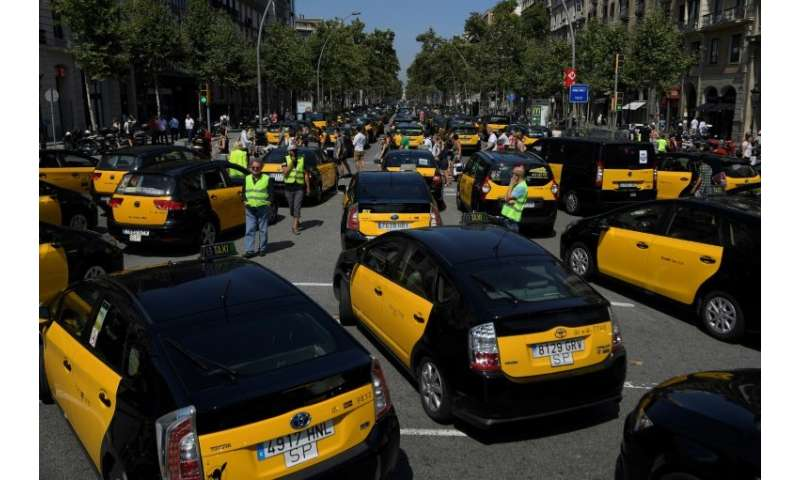 Taxi drivers blocked the Gran Via in Barcelona on July 27, 2018 during a strike. Taxi drivers in Madrid joined the action on Jul