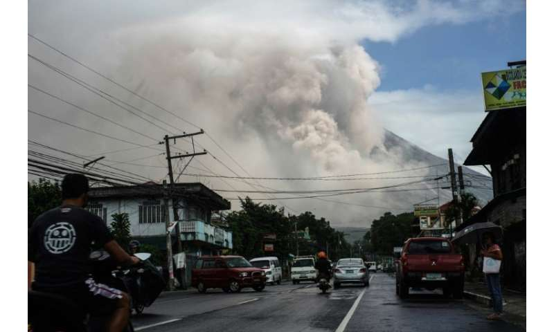 Tens of thousands of people have fled their homes since Mount Mayon began belching flaming lava, superheated rocks and ash