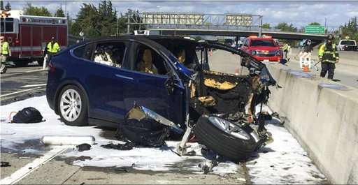 Tesla: Crash was worsened by missing freeway barrier shield
