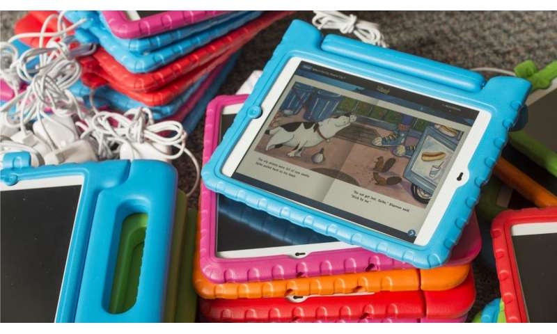 Texts and tablets more than double time parents spend reading to kids