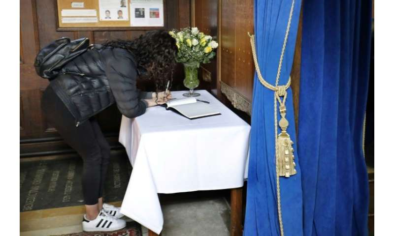 The college opened a book of condolences in the chapel and placed a black-and-white picture of him on a notice board.
