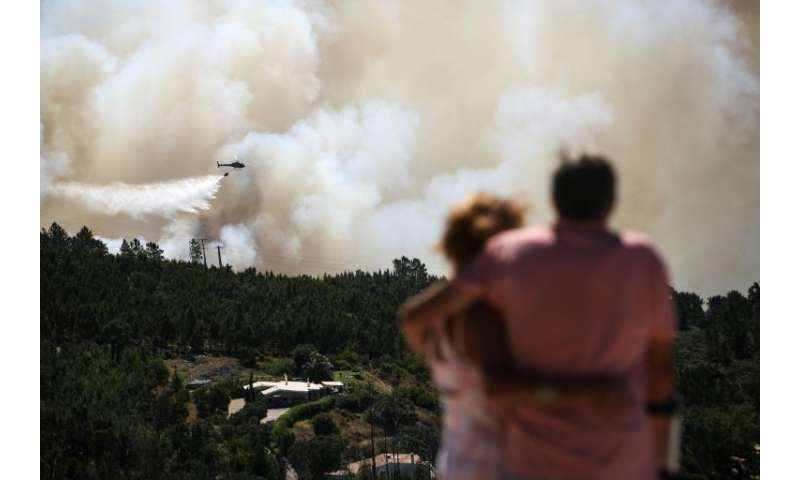 The fires have left 32 people injured, one seriously, and forced hundreds from their homes as the flames encircled urban areas i