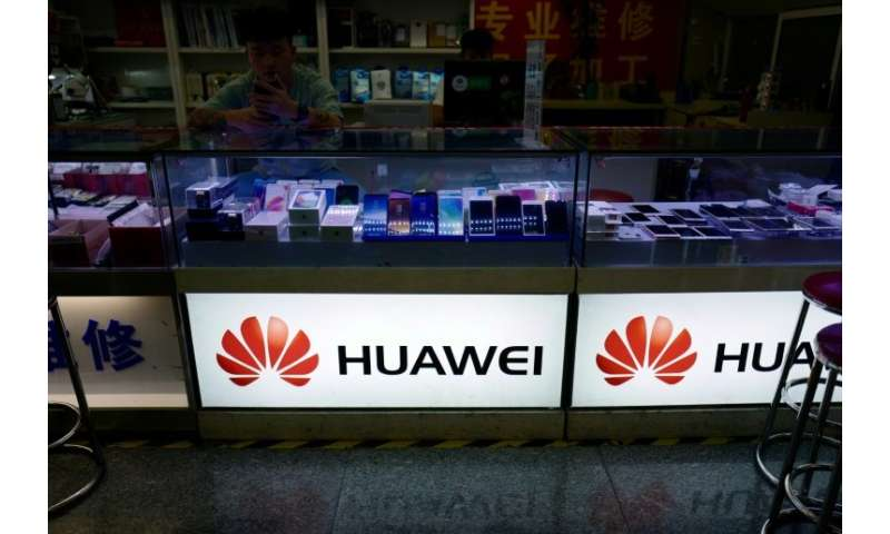 The Huawei logo is seen in a shop in Shanghai on May 3, 2018; The Chinese phone maker was able to access Facebook data to get th