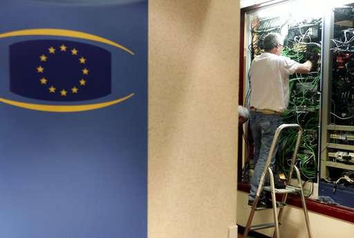 The Latest: Complaints vs Google, Facebook under new EU law