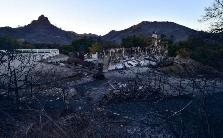 The remnants of a home destroyed in the Woolsey fire are seen along Mulholland Highway in the hills above Malibu, California