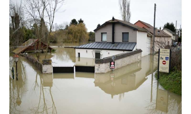 There's plenty of mopping ahead for residents of illennes-sur-Seine, west of Paris